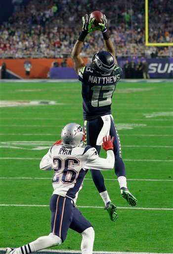 Seattle Seahawks wide receiver Chris Matthews (13) catches an 11-yard touchdown pass against New England Patriots cornerback Logan Ryan (26) during the first half of NFL Super Bowl XLIX football game Sunday, Feb. 1, 2015, in Glendale, Ariz. (AP Photo/Bryn
