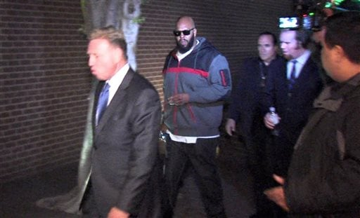 """FILE - In this Friday, Jan. 30, 2015 file image from video, Death Row Records founder Marion """"Suge"""" Knight, right, walks into the Los Angeles County Sheriffs department in the early morning in connection with a hit-and-run incident that left one man dead."""