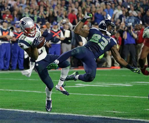 New England Patriots strong safety Malcolm Butler (21) intercepts a pass intended for Seattle Seahawks wide receiver Ricardo Lockette (83) during the second half of NFL Super Bowl XLIX football game Sunday, Feb. 1, 2015, in Glendale, Ariz. (AP Photo)