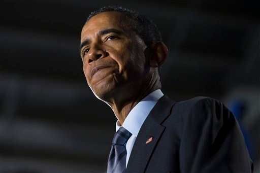 President Barack Obama pauses as he delivers remarks at the Department of Homeland Security on his FY2016 budget proposal, on Monday, Feb. 2, 2015, in Washington. Obama warned congressional Republicans Monday that he won't accept a spending plan that boos