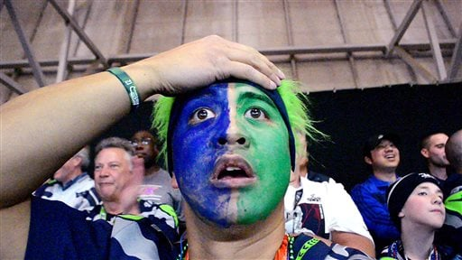 In this image taken from video provided by Norb Caoili, Seattle Seahawks' fan Norb Caoili grabs his head in the final moments of the Super Bowl as the Seahawks lose to the New England Patriots Sunday, Feb. 1, 2015, in Glendale, Ariz. (AP)