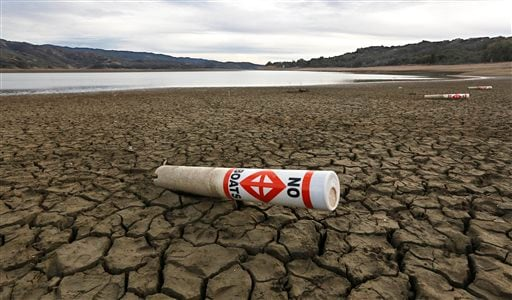 FILE - In this Feb. 4 2014 file photo, a warning buoy sits on the dry, cracked bed of Lake Mendocino near Ukiah, Calif. (AP)