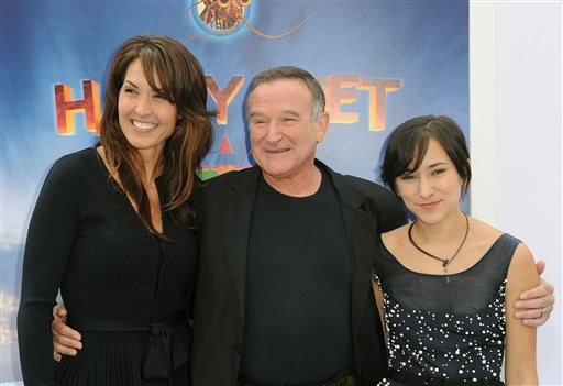 "FILE - In this Nov. 13, 2011 file photo, Susan Schneider, from left, Robin Williams, and Zelda Williams arrive at the premiere of ""Happy Feet Two"" at Grauman's Chinese Theater, in Los Angeles. (AP)"