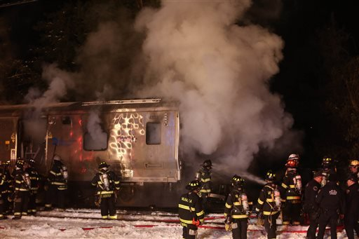 Firefighters work the scene of a collision between a Metro-North Railroad passenger train and a vehicle in Valhalla, N.Y., Tuesday, Feb. 3, 2015. (AP Photo/The Journal-News, Frank Becerra, Jr.)