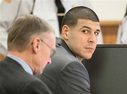 Former New England Patriots player Aaron Hernandez, right, glances towards the Lloyd family during his trial at Bristol County Superior Court in Fall River, Ma., Tuesday, Feb. 3, 2015.