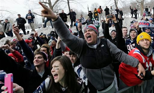 New England Patriots fans cheer as duck boats carrying players pass during a parade in Boston, Wednesday, Feb. 4, 2015, to honor the NFL football team's victory over the Seattle Seahawks in Super Bowl XLIX in Glendale, Ariz. (AP Photo/Charles Krupa)