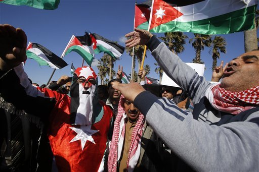Jordanians chant slogans to show their support for the government against terror as they were waiting for Jordan's King Abdullah II, returning from the U.S., at Queen Alia Airport in Amman, Jordan Feb. 4, 2015. (AP Photo/Raad Adayleh)