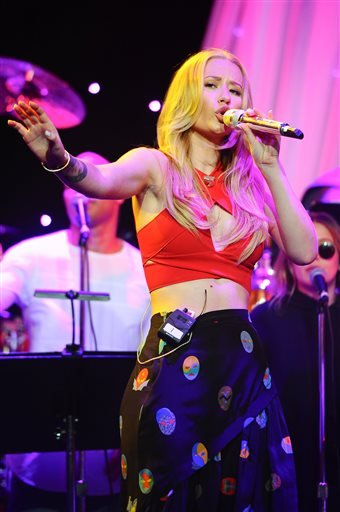Singer Iggy Azalea performs at the Clive Davis Pre-Grammy Gala Press Day at the Beverly Hilton hotel on Thursday, Feb. 5, 2015 in Beverly Hills, Calif.