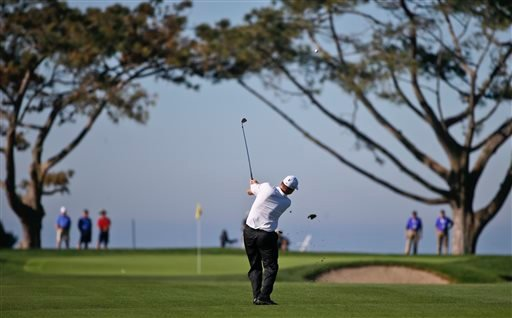 Chad Campbell hits his approach to the first green on the south course at Torrey Pines during the second round of the Farmers Insurance Open golf tournament Friday, Feb. 6, 2015, in San Diego. (AP Photo/Lenny Ignelzi)