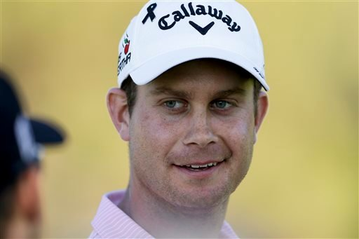 Harris English, right, talks with Ben Martin as they wait to hit their tee shots on the 18th hole of the north course during the second round of the Farmers Insurance Open golf tournament Friday, Feb. 6, 2015, in San Diego. (AP Photo/Gregory Bull)