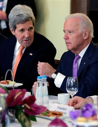 U.S. Secretary of State John Kerry, left, talks to U.S. Vice President Joe Biden prior to a meeting with Ukraine's President Petro Poroshenko during the 51. Munich Security Conference in Munich, Germany, Saturday, Feb. 7, 2015. The conference on security