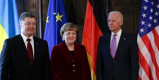 From left: Ukraine's President Petro Poroshenko, German Chancellor Angela Merkel and U.S. Vice President Joe Biden pose for the media prior to a meeting during the 51. Munich Security Conference in Munich, Germany, Saturday, Feb. 7, 2015. The conference o