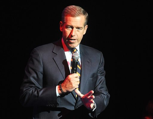 In this Nov. 5, 2014 file photo, Brian Williams speaks at the 8th Annual Stand Up For Heroes, presented by New York Comedy Festival and The Bob Woodruff Foundation in New York. Williams says he's temporarily stepping away from his nightly newscast amid qu