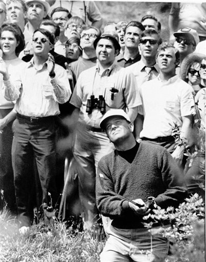 In this June 20, 1966, file photo, Billy Casper reacts after running a 25-foot putt into the cup on the 11th green during his playoff with Arnold Palmer for the U.S. Open title in San Francisco. Casper, a prolific winner on the PGA Tour whose career was n