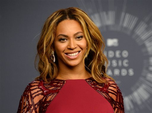 In this Aug. 24, 2014 file photo, Beyonce backstage at the MTV Video Music Awards in Inglewood, Calif. Beyonce is competing against, Sam Smith, Beck, Ed Sheeran, and Pharrell for Album of the Year at this year's Grammy Awards on Sunday, Feb. 8. (Photo by