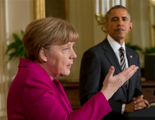 President Barack Obama listens as German Chancellor Angela Merkel speaks during their joint news conference in the East Room of the White House in Washington, Monday, Feb. 9, 2015. The leaders were expected to discuss the ongoing conflict in Ukraine, and