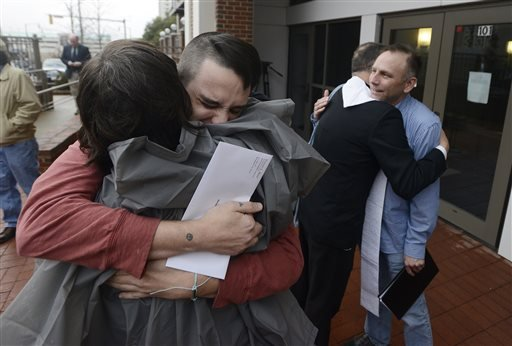 Justin Morgan, left, and Glenn Cannon, right, hug supporters after getting their marriage license at the Montgomery County Probate Office in Montgomery, Ala. on Monday Febr. 9, 2015. Gay couples began getting married in Alabama on Monday morning, despite