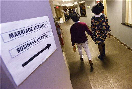 Shante Wolfe, left, and Tori Sisson walk to get their marriage license at the Montgomery County Probate Office in Montgomery, Ala. on Monday, Feb. 9, 2015. Sisson and Wolfe were the first couple in the county to file their marriage license. Gay couples be