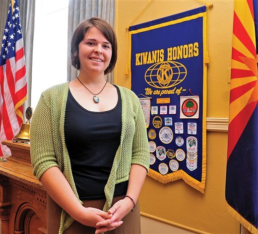 In this May 30, 2013, photo, Kayla Mueller is shown after speaking to a group in Prescott, Ariz. The parents of an American woman held by Islamic State militants say they have been notified of her death. Carl and Marsha Mueller, the parents of Kayla Jean