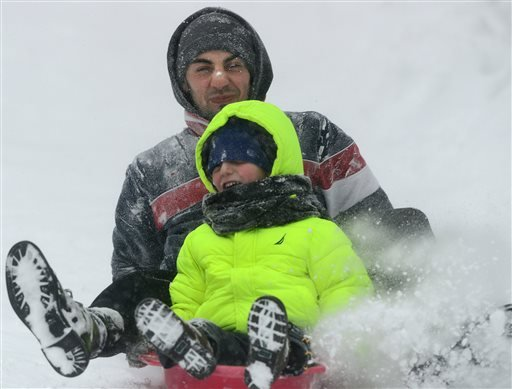 Armin Budnjo and his younger brother, Ajdin, make their way down a hill at Val Bialas Sports Center, Monday, Feb. 9, 2015, in Utica, N.Y. The third major winter storm in less than two weeks inflicted fresh snow across New England and portions of New York