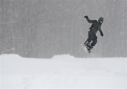 A person uses a snowboard at Val Bialas Sports Center, Monday, Feb. 9, 2015, in Utica, N.Y. The third major winter storm in less than two weeks inflicted fresh snow across New England and portions of New York state on Monday. (AP Photo/Observer-Dispatch,