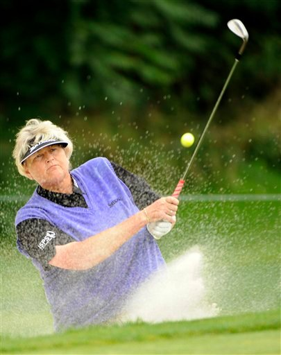 This is a Saturday, Aug. 16, 2014 file photo of Laura Davies, of England, as she blasts out of a trap on the second hole during third round of the Wegmans Championship LPGA golf tournament in Pittsford, N.Y.