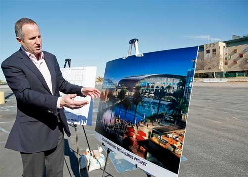 Chris Meany, senior vice president of Hollywood Park Land Company unveils an architectural rendering of a proposed NFL stadium at Hollywood Park in Inglewood, Calif., Monday, Jan. 5, 2015.