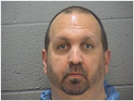 This image provided by the Durham County Sheriff's office shows a booking photo of Craig Stephen Hicks, 46, who was arrested on three counts of murder early Wednesday Feb. 11, 2015. (AP Photo/Durham County Sheriff)