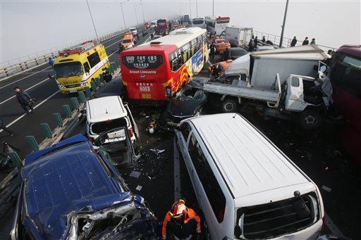 Damaged vehicles sit on Yeongjong Bridge in Incheon, South Korea, Wednesday, Feb. 11, 2015.(AP Photo/Yonhap, Suh Myung-gon)