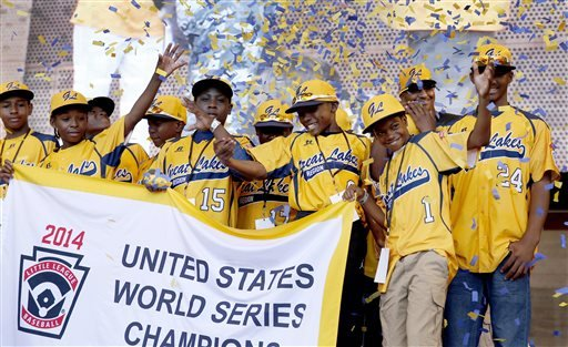 In this Aug. 27, 2014, file photo, members of the Jackie Robinson West Little League baseball team participate in a rally celebrating the team's U.S. Little League Championship in Chicago.