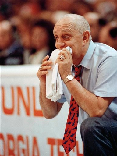 In this April 2, 1990, file photo, UNLV coach Jerry Tarkanian chews on his towel while watching his team play Duke in the championship game of the NCAA college basketball Final Four in Denver.