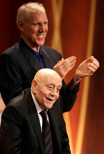 In this Sept. 8, 2013, file photo, inductee Jerry Tarkanian, below, receives a warm welcome from the crowd as Hall of Famer Bill Walton, top, applauds during the enshrinement ceremony for the 2013 class of the Naismith Memorial Basketball Hall of Fame.