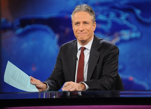 "FILE - This Nov. 30, 2011 file photo shows television host Jon Stewart during a taping of ""The Daily Show with Jon Stewart"" in New York. Comedy Central announced Tuesday, Feb. 10, 2015, that Stewart will will leave ""The Daily Show"" later this year. (AP)"