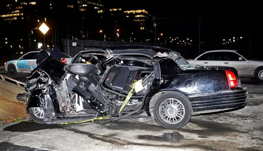 """A car remains on the scene of an accident in New York, Wednesday, Feb. 11, 2015, that killed longtime """"60 Minutes"""" correspondent Bob Simon."""