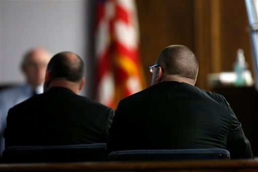 Former Marine Cpl. Eddie Ray Routh, right, watches the dash cam video of the high-speed chase he led Lancaster, Texas police on in Chris Kyle's truck, during Routh's trial in Stephenville, Texas on Thursday, Feb. 12, 2015. (AP)