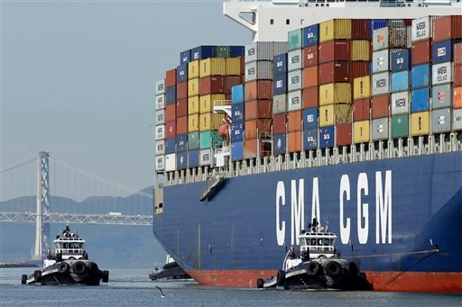A container ship is guided by tugboats as it arrives at the Port of Oakland to be unloaded Thursday, Feb. 12, 2015, in Oakland, Calif. Companies that operate marine terminals didn't call workers to unload ships Thursday that carry car parts, furniture, cl