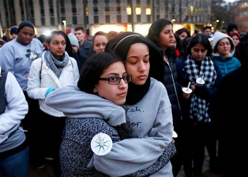 N.C. State sophomore Firdaws Chahrour, right, hugs Danyah Dahbour before a vigil on the N.C. State campus for Deah Shaddy Barakat, 23, his wife Yusor Mohammad Abu-Salha, 21, and Abu-Salha's sister, Razan Mohammad Abu-Salha, 19, Thursday, Feb. 12, 2015.