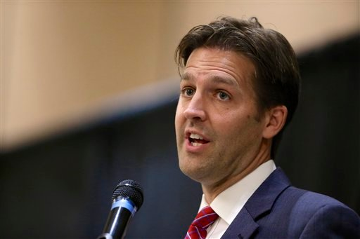 In this Oct. 22 2014 file photo, then-Nebraska Republican Senate candidate, now Sen. Ben Sasse, R-Neb. speaks in Lincoln, Neb. Millions of immigrants benefiting from President Barack Obama's executive actions could get a windfall from the IRS, a reversal