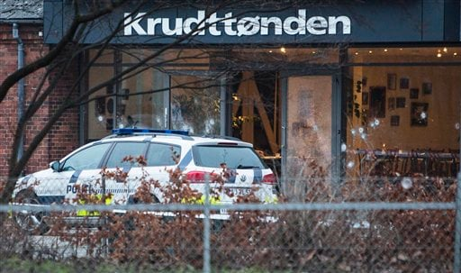 The scene outside the Copenhagen cafe, with bullet marked window, where a gunman opened fire Saturday, Feb. 14, 2015, in what is seen as a likely terror attack against a free speech event organized by an artist who had caricatured the Prophet Muhammad. Th