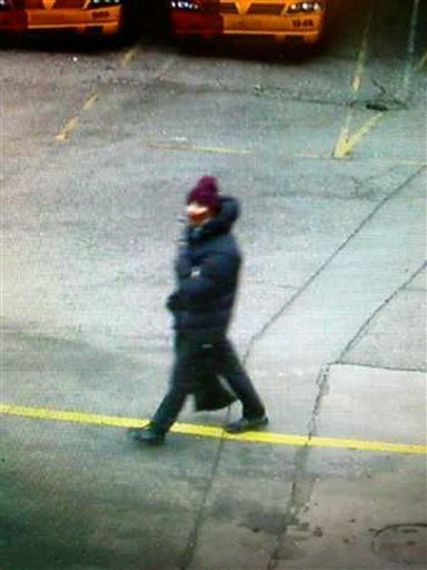 In this photo dated Saturday Feb. 14, 2015, issued by Copenhagen Police believed to show the suspect in a shooting at a freedom of speech event in Copenhagen, in a photo believed to be taken on a street camera near to where the getaway car was later found