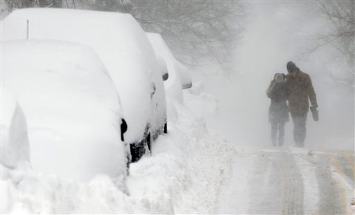 Graham Jamison, right, and Austin Anschultz walk through blowing snow on Beacon Hill in Boston, Sunday, Feb. 15, 2015. A blizzard warning was in effect for coastal communities from Rhode Island to Maine, promising heavy snow and powerful winds to heap mor