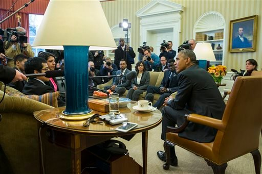 """In this Feb. 4, 2015, file photo, President Barack Obama meets with a group of """"Dreamers"""" in the Oval Office of the White House in Washington. A federal judge temporarily blocked Obama's executive action on immigration Monday, Feb. 16, 2015, giving a coal"""