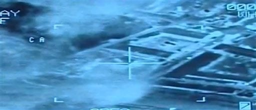 This video image from aerial footage released by the Egyptian Defense Ministry, shows an airstrike on Islamic State group positions, in Libya, Monday, Feb. 16, 2015. Egyptian warplanes struck Islamic State targets in Libya in swift retribution for the ext
