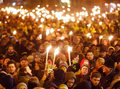 Hundreds of people gather for a vigil near the cultural club in Copenhagen, Denmark, Monday, Feb. 16, 2015. The slain gunman behind two deadly shooting attacks in Copenhagen was released from jail just two weeks ago and might have become radicalized there