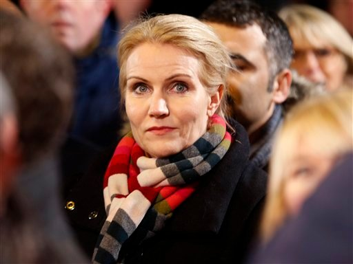 Danish Prime Minister Helle Thorning-Schmidt takes part in a vigil near the cultural club in Copenhagen, Denmark, Monday, Feb. 16, 2015. The slain gunman behind two deadly shooting attacks in Copenhagen was released from jail just two weeks ago and might