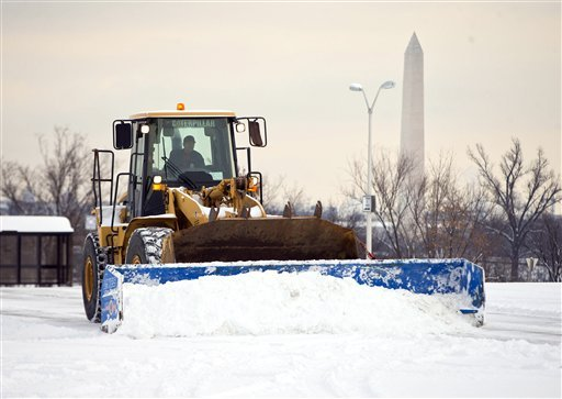 A plow removes snow from the parking lot at the Pentagon after a winter storm, on Tuesday, Feb. 17, 2015, in Washington. The season's first major snow storm to blast large parts of the South dropped up to 8 inches of snow around the Washington area.(AP Ph