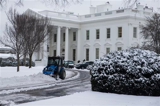 A plow removes snow from the White House driveway after a winter storm, on Tuesday, Feb. 17, 2015, in Washington. The season's first major snow storm to blast large parts of the South dropped up to 8 inches of snow around the Washington area. (AP Photo/Ev