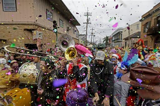 Revelers play brass band music as they begin the march of the Society of Saint Anne Mardi Gras parade, on Mardi Gras in New Orleans, Tuesday, Feb. 17, 2015. (AP)