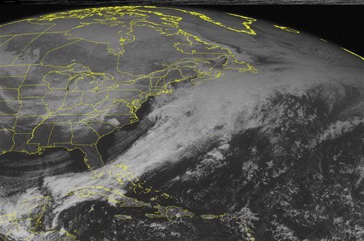 This NOAA satellite image taken Wednesday, Feb. 18, 2015, at 1:00 PM EST shows a winter storm system over the Ohio River Valley that is approaching the eastern seaboard of the United States with very cold air behind it moving across the Midwest. (AP)
