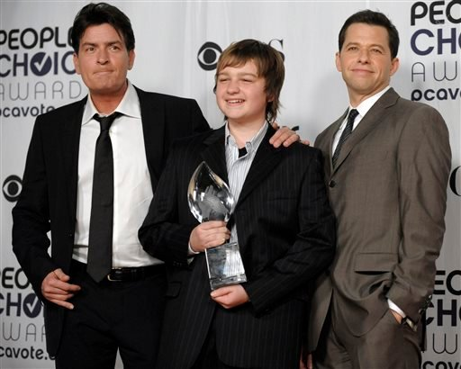 "In this Jan. 7, 2009 file photo, from left, Charlie Sheen, Angus T. Jones and Jon Cryer, pose for a picture backstage with their favorite TV comedy award for ""Two and a Half Men"" at the 35th Annual People's Choice Awards in Los Angeles."